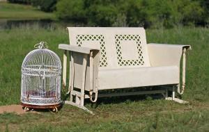 glider and bird cage