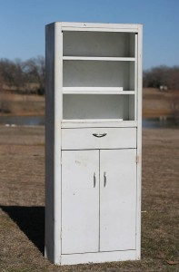 white metal cabinet missing glass doors on top