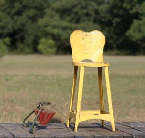 yellow stool and christmas tree stand
