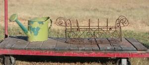 green water bucket and window flower holder